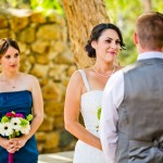Bride-and-Groom-at-the-Alter-with-Bridesmaid