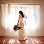 Bride-at-window-with-Bouquet