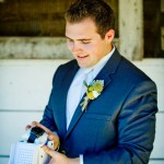 Groom-opening-gift-at-stables